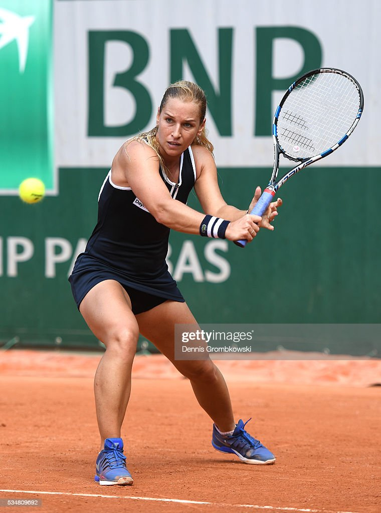 Dominica Cibulkova of Slovakia hits a backhand during the Ladies Singles third round match against Carla Suarez Navarro of Spain on day seven of the 2016 French Open at Roland Garros on May 28, 2016 in Paris, France.