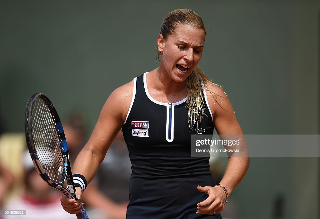 Dominica Cibulkova of Slovakia reacts during the Ladies Singles third round match against Carla Suarez Navarro of Spain on day seven of the 2016 French Open at Roland Garros on May 28, 2016 in Paris, France.