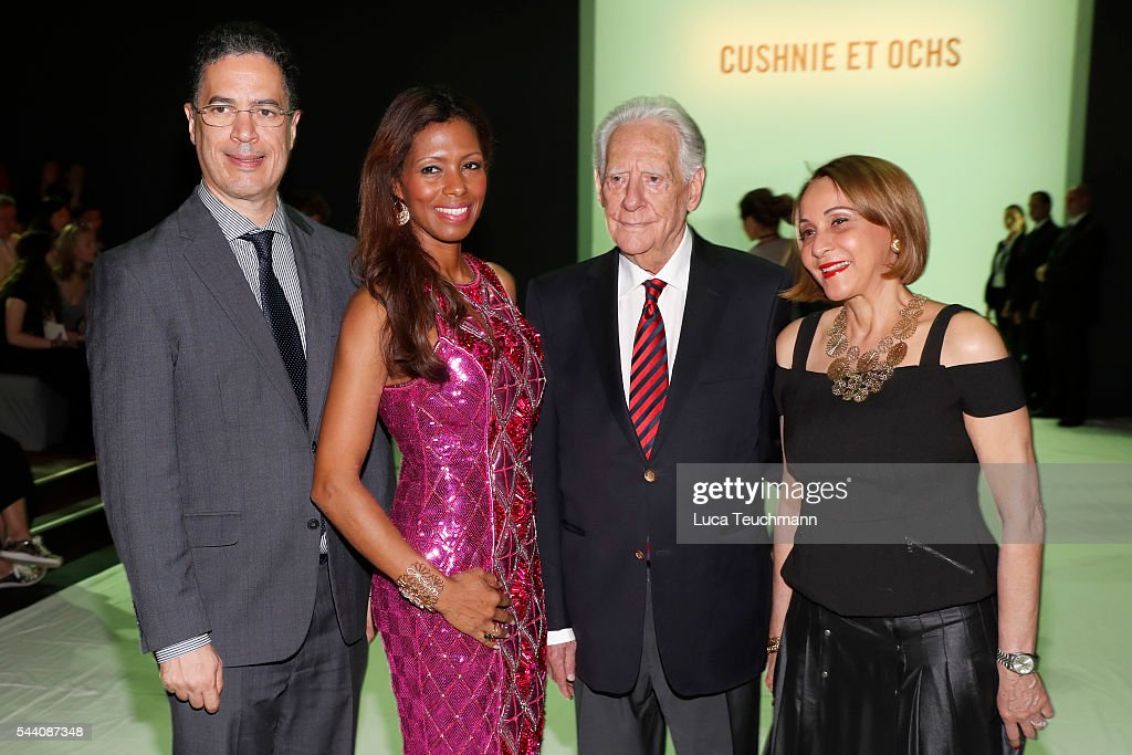 Dominican ambassador to Germany Rafael Calventi (2ndR), his wife Maibe Altagracia Sanchez de Calventi (R) and guests attend the Cushnie Et Ochs show during the Mercedes-Benz Fashion Week Berlin Spring/Summer 2017 at Erika Hess Eisstadion on July 1, 2016 in Berlin, Germany.