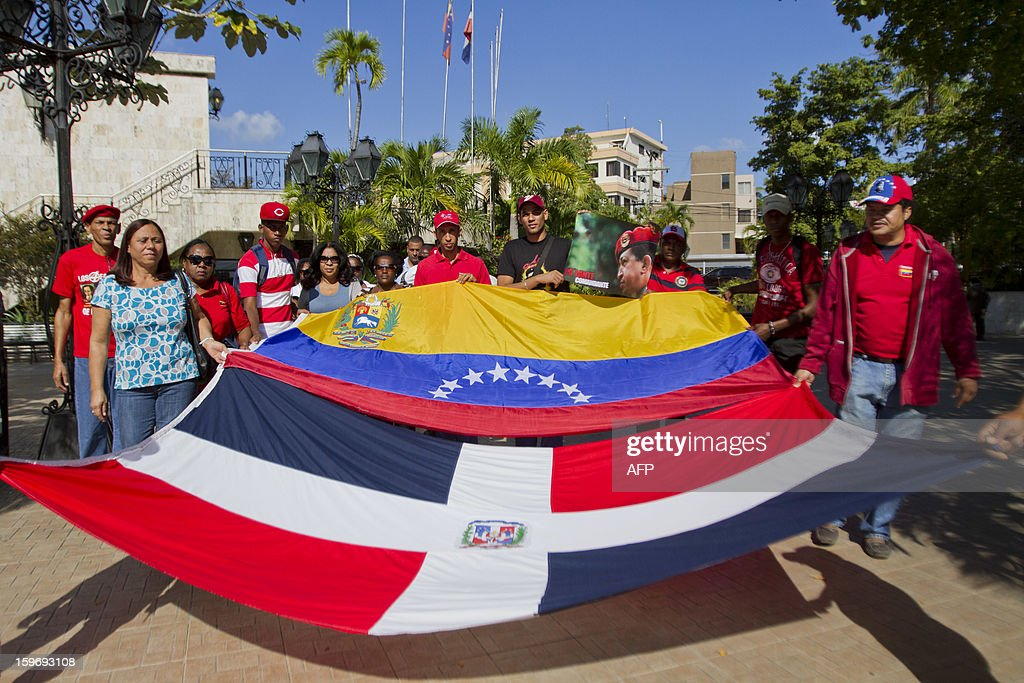 Dominican citizens supporting Venezuelan President Hugo Chavez pose before the start of a pilgrimage from Santo Domingo to the Virgin of Altagracia, in Higuey, 155 km east, praying for the health of the Venezuelan leader, on January 18, 2013. AFP PHOTO/Erika SANTELICES