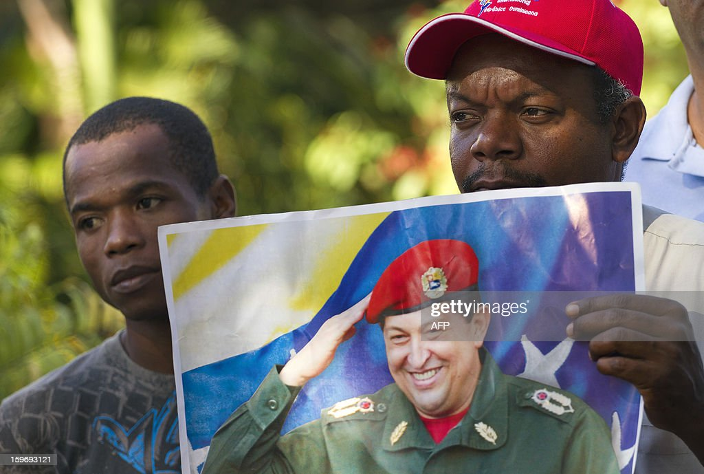 Dominican citizens supporting Venezuelan President Hugo Chavez take part in a pilgrimage from Santo Domingo to the Virgin of Altagracia, in Higuey, 155 km east, praying for the health of the Venezuelan leader, on January 18, 2013. AFP PHOTO/Erika SANTELICES