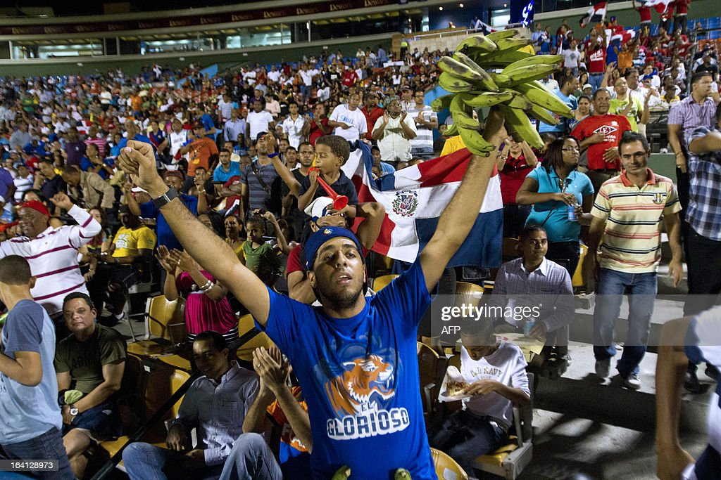 A Dominican fan celebrates during the World Baseball Classic final game against Puerto Rico at the Quisqueya stadium in Santo Domingo on March 19, 2013. Dominican Republic won by 3-0. AFP PHOTO / Erika SANTELICES