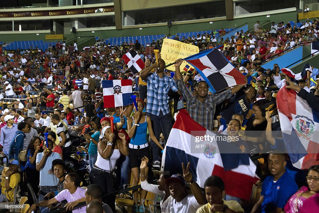 Dominican fans celebrate during the World Baseball Classic final game against Puerto Rico at the Quisqueya stadium in Santo Domingo on March 19, 2013. Dominican Republic won by 3-0. AFP PHOTO / Erika SANTELICES