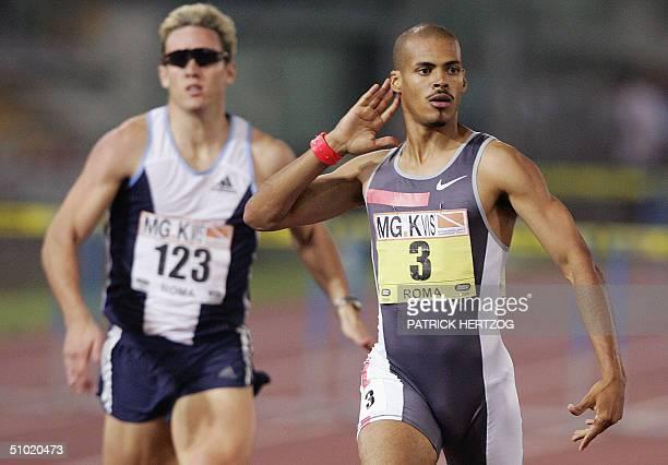 Dominican Felix Sanchez celebrates after winning the 400 meters hurdles ahead of South African Herbert Llewellyn in the Golden Gala of Athletics meet...