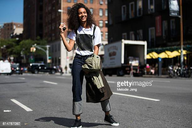 Dominican model Luisana Gonzalez wears a white tshirt with a camouflage square blue jeans with a long cuff and black sneakers after the Proenza...