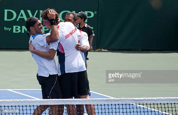 Dominican national tennis team members celebrate after Victor Estrella and Jos Hernandez won in three sets their Davis Cup match against Chilean team...