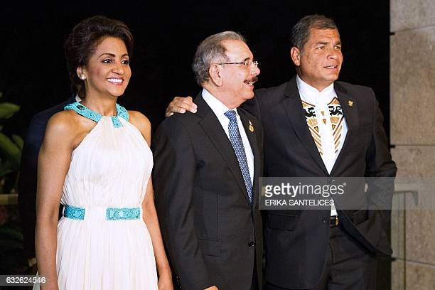 Dominican President Danilo Medina and First Lady Candida Montilla welcome Ecuadorean President Rafael Correa before the opening ceremony of the Fifth...