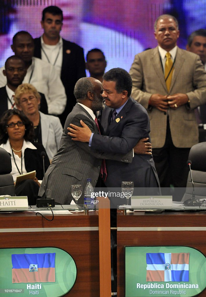 Dominican president Leonel Fernandez (R) and Haiti's Rene Preval greet each other during the World Summit for the Future of Haiti in Punta Cana, Dominican Republic, on June 2, 2010. Top officials from Europe and the Americas are meeting with the goal of firming up international plans for the massive rebuilding effort and offers of financial support promised to Haiti. AFP PHOTO/Erika SANTELICES