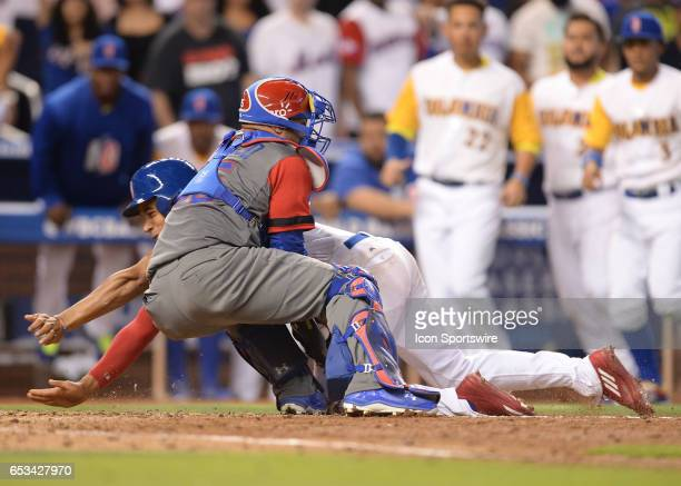 Dominican Republic catcher Welington Castillo makes an incredible play by holding on to the ball and tagging Colombia outfielder Oscar Mercado during...