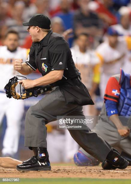 Dominican Republic catcher Welington Castillo makes an incredible play by holding on to the ball and tagginf Colombia outfielder Oscar Mercado during...