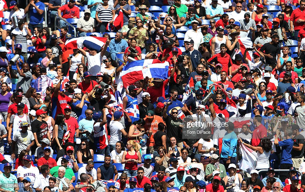 Dominican Republic fans celebrate during Pool 2, Game 6 against Team Puerto Rico in the second round of the 2013 World Baseball Classic on Saturday, March 16, 2013 at Marlins Park in Miami, Florida. (Photo by Tom DiPace/WBCI/MLB Photos via Getty Images) *** Local Caption **