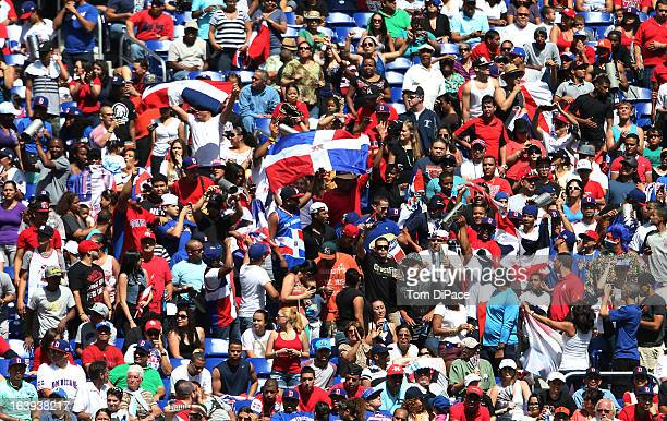 Dominican Republic fans celebrate during Pool 2 Game 6 against Team Puerto Rico in the second round of the 2013 World Baseball Classic on Saturday...