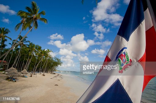Dominican republic flag in the beach