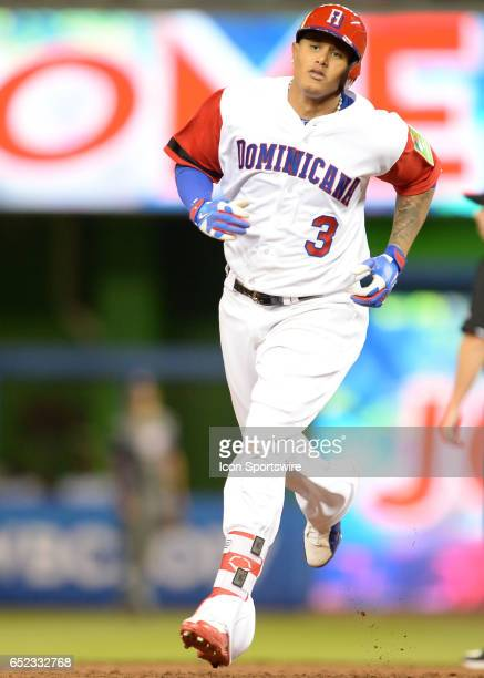 Dominican Republic infielder Manny Machado turn on second base after he home run during the first round pool C World Baseball Classic game between...
