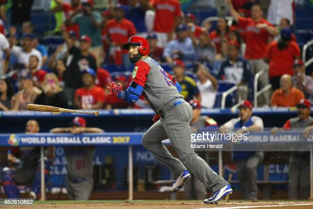 Dominican Republic left fielder Jose Bautista follows through on a sacrifice fly during the first inning of a World Baseball Classic first round Pool...