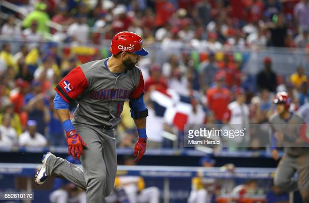 Dominican Republic left fielder Jose Bautista reaches on a fielding error by Colombia shortstop Donovan Solano during the third inning of a World...