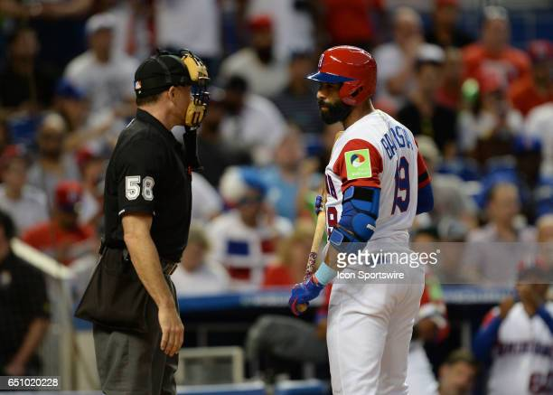 Dominican Republic outfielder Jose Bautista argues on a strike out call during the World Baseball Classic 1st Round Pool C game between Canada and...