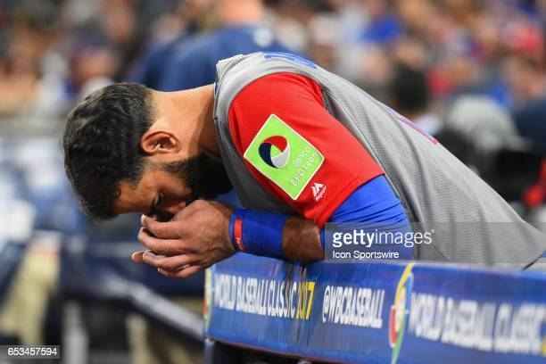 Dominican Republic Outfielder Jose Bautista puts his head down before the ninth inning of a World Baseball Classic second round Pool F game against...