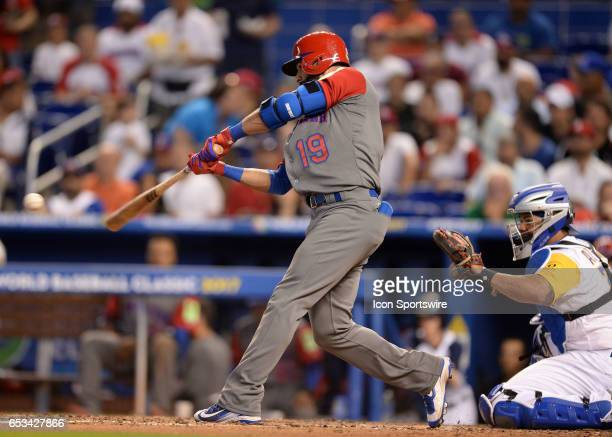 Dominican Republic outfielder Jose Bautista reaches on a fielders error by Colombia infielder Donovan Solano during top of the third inning during...