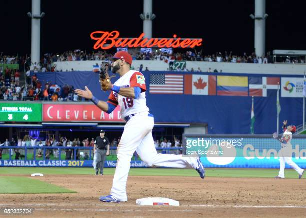 Dominican Republic outfielder Jose Bautista runs to the mount to celebrate during the first round pool C World Baseball Classic game between the...