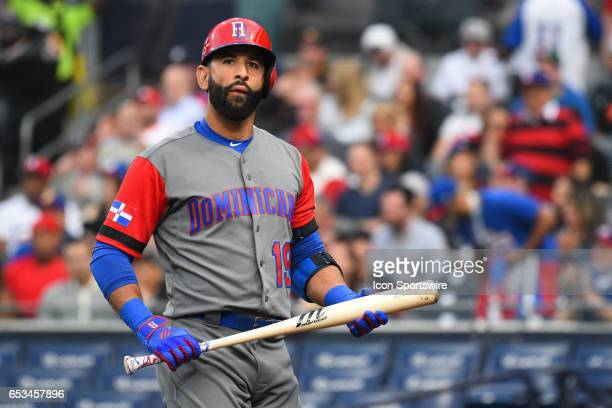 Dominican Republic Outfielder Jose Bautista walks back to the dugout after striking out during the first inning of a World Baseball Classic second...