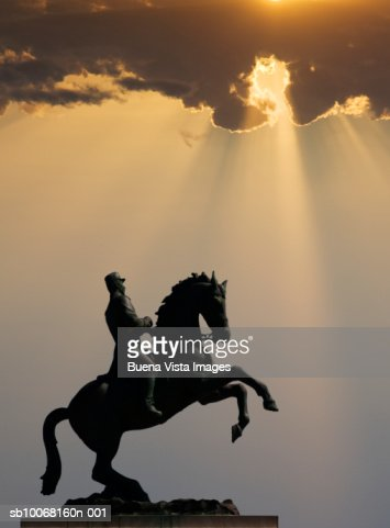 Dominican Republic, Puerto Plata, statue of man on horse at sunset : Stock Photo