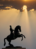 Dominican Republic, Puerto Plata, statue of man on horse at sunset