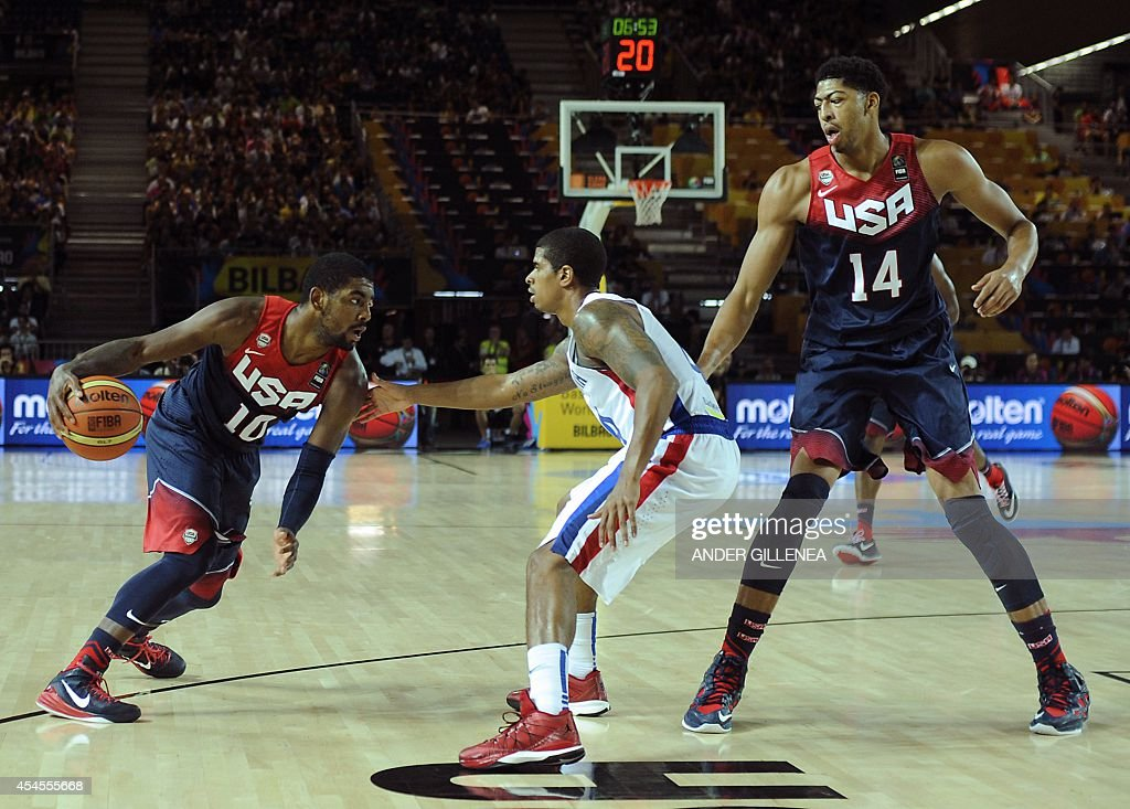 Dominican Republic's guard Edgar Sosa vies with US centre Anthony Davis and US guard Kyrie Irving during the 2014 FIBA World basketball championships...
