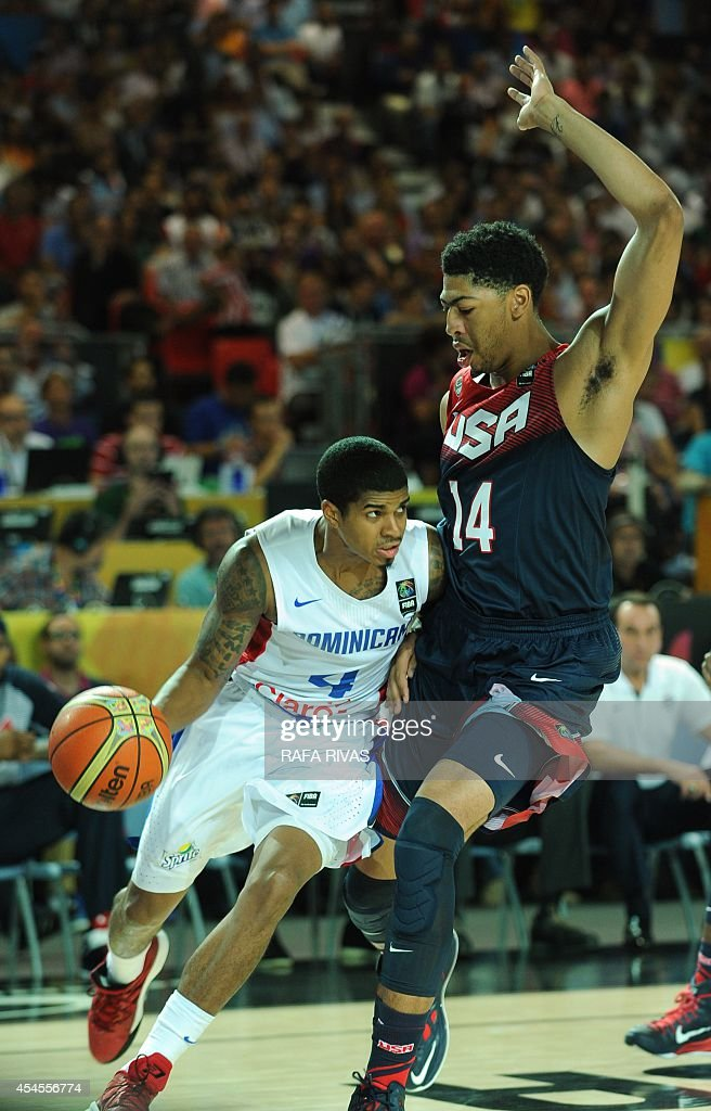 Dominican Republic's guard Edgar Sosa vies with US centre Anthony Davis during the 2014 FIBA World basketball championships group C match Dominican...