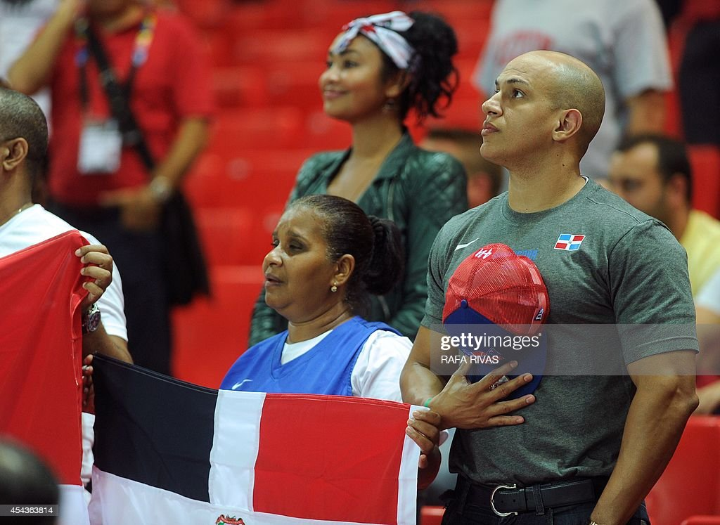 Dominican Republic's supporters listen to their national anthem before the 2014 FIBA World basketball championships group C match Ukraine vs Dominican Republic at the Bizkaia Arena in Bilbao on August 30, 2014.