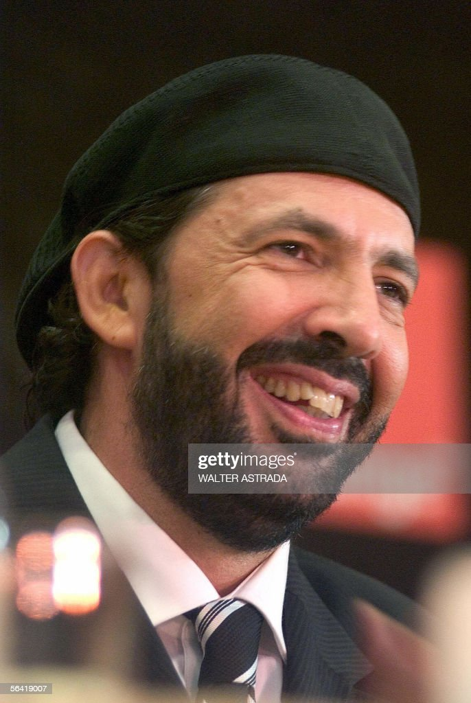 Dominican singer and songwriter <a gi-track='captionPersonalityLinkClicked' href=/galleries/search?phrase=Juan+Luis+Guerra&family=editorial&specificpeople=208921 ng-click='$event.stopPropagation()'>Juan Luis Guerra</a>, smiles during a media conference to present '<a gi-track='captionPersonalityLinkClicked' href=/galleries/search?phrase=Juan+Luis+Guerra&family=editorial&specificpeople=208921 ng-click='$event.stopPropagation()'>Juan Luis Guerra</a> and his 4-40 band tour 20 years' in Santo Domingo, Dominican Republic, 07 December, 2005. The show is scheduled for December 17. AFP PHOTO/Walter ASTRADA