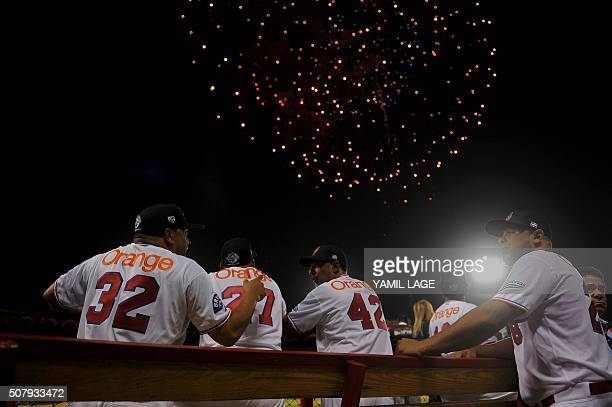 Dominican team members confer during the opening ceremony of the 2016 Caribbean baseball series on February 1 2016 in Santo Domingo Dominican...