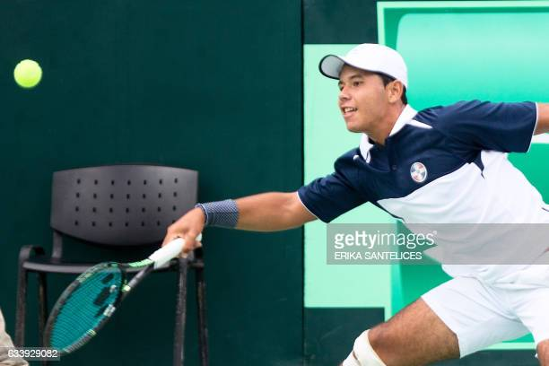 Dominican tennis player Nick Hardt returns the ball to Chilean tennis player Nicolas Jarry during the Davis World Cup fifth singles tennis match...