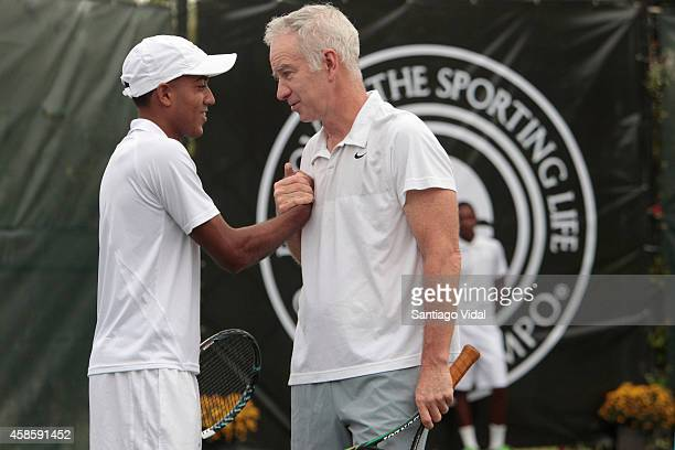Dominican tennis player Pedro Nolasco shakes hands with Jonh McEnroe prior an exhibition match between John McEnroe and Jim Courier at Casa de Campo...