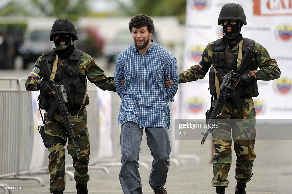 Dominican-born U.S. citizen dealer Eduardo Acosta Mejías, accused of drug trafficking is taken under custody to be deported to Colombia, in Caracas on November 14, 2012.