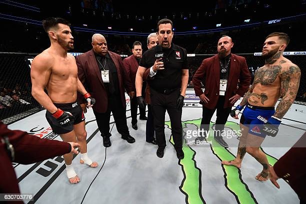 Dominick Cruz and Cody Garbrandt face off in their UFC bantamweight championship bout during the UFC 207 event at TMobile Arena on December 30 2016...