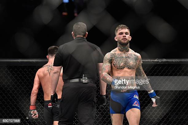 Dominick Cruz and Cody Garbrandt walk back to their corners in their UFC bantamweight championship bout during the UFC 207 event at TMobile Arena on...