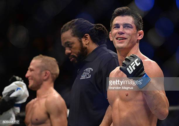 Dominick Cruz and TJ Dillashaw wait to hear the judges decision after in their UFC bantamweight championship bout during the UFC Fight Night event...