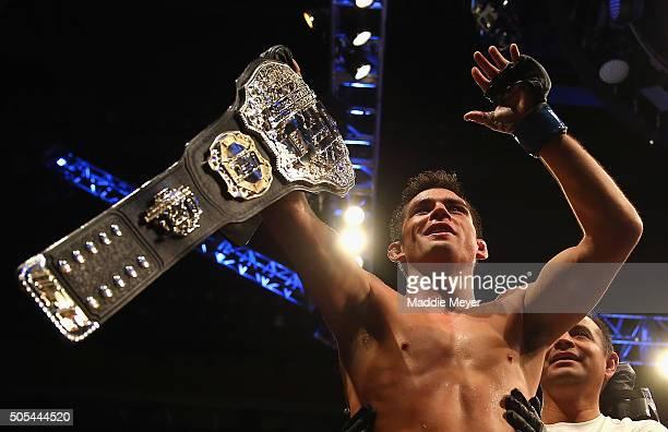 Dominick Cruz celebrates defeating TJ Dillashaw to win the World Bantamweight Championship during UFC Fight Night 81 at TD Banknorth Garden on...