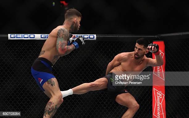 Dominick Cruz kicks Cody Garbrandt in their UFC bantamweight championship bout during the UFC 207 event on December 30 2016 in Las Vegas Nevada