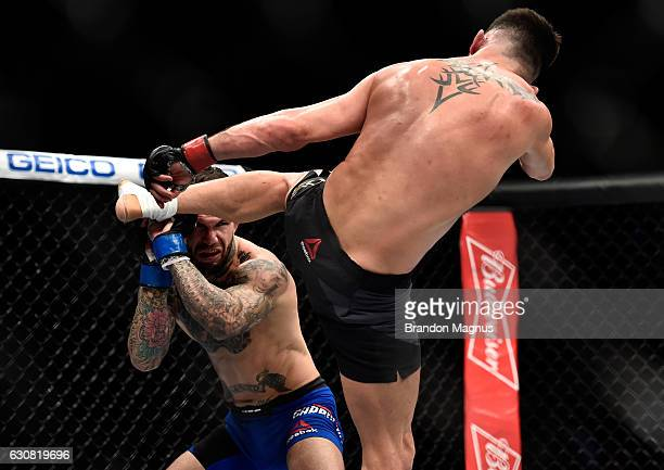 Dominick Cruz kicks Cody Garbrandt in their UFC bantamweight championship bout during the UFC 207 event at TMobile Arena on December 30 2016 in Las...
