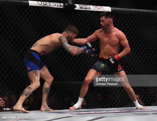 Dominick Cruz punches Cody Garbrandt in their UFC bantamweight championship bout during the UFC 207 event on December 30 2016 in Las Vegas Nevada