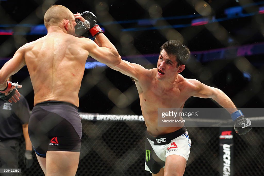 Dominick Cruz (R) punches T.J. Dillashaw in their bantamweight bout during UFC Fight Night 81 at TD Banknorth Garden on January 17, 2016 in Boston, Massachusetts.