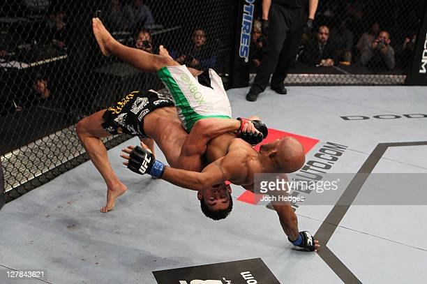 Dominick Cruz suplexes Demetrious Johnson during the UFC on Versus event at the Verizon Center on October 1 2011 in Washington DC