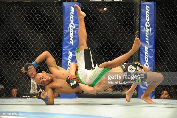 Dominick Cruz takes down Demetrious Johnson during the UFC Bantamweight title fight on Versus event at the Verizon Center on October 1 2011 in...