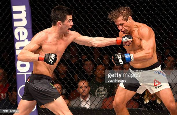 Dominick Cruz throws a left punch at Urijah Faber in their UFC bantamweight championship bout during the UFC 199 event at The Forum on June 4 2016 in...