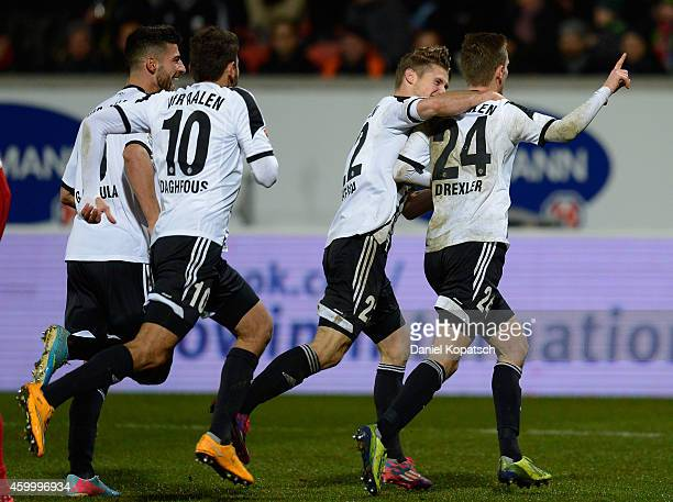 Dominick Drexler of Aalen celebrates his team's first goal with team mates Michael Klauss and Marcel Reichwein of Aalen during the second Bundesliga...