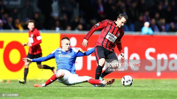 Dominick Drexler of Kiel and Anton Fink of Chemnitz compete for the ball during the third league match between Holstein Kiel and Chemnitzer FC at...
