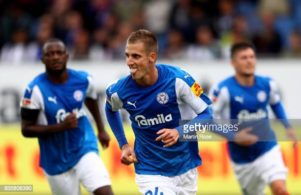 Dominick Drexler of Kiel celebrates after he scores the 3rd goal by penalty during the Second Bundesliga match between Holstein Kiel and SpVgg...
