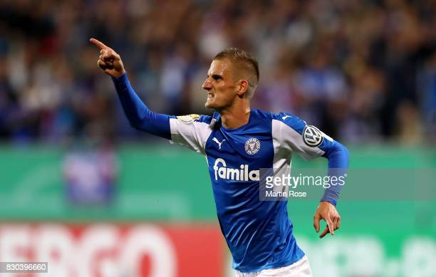 Dominick Drexler of Kiel celebrates after he scores the equalzing goal by penalty during the DFB Cup first round match between Holstein Kiel and...